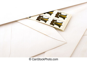 stamps and envelopes - forever stamps against white...
