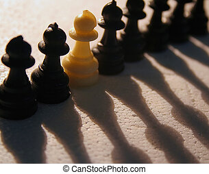 Stand Alone - Different - a single white pawn among black...