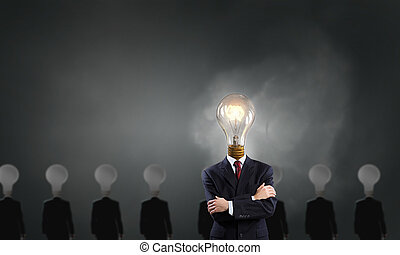 Stand out - Businessman in suit with light bulb instead of ...