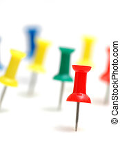 """""""Stand out from the crowd"""" concept with color pins"""