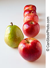 Stand out from the Crowd - Green pear standing out from a...