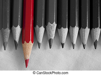 Stand out from the crowd - Red pencil amongst a row of ...