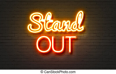 Stand out neon sign on brick wall background. - Stand out...