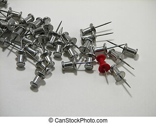 stand out - single red push pin among silver