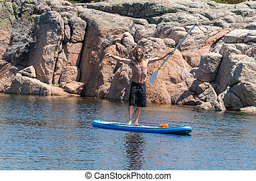 Stand up paddle on a lake