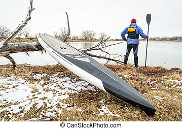 Stand up paddleboard in early spring