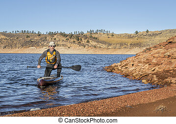 stand up paddleboard on Horsetooth Reservoir - senior male ...