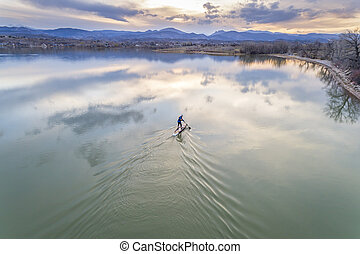stand up paddleboard on lake - aerial view
