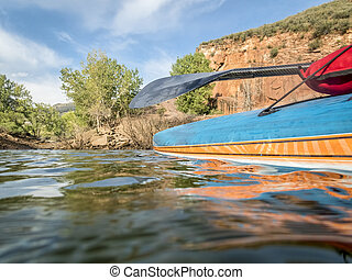 stand up paddleboard on lake in Colorado