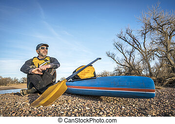 stand up paddling on a river