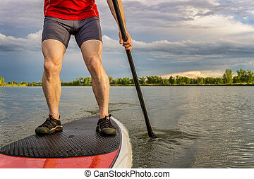 stand up paddling on lake