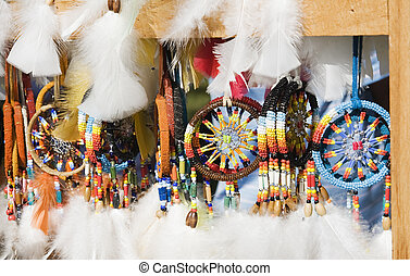 colorful beadwork - stand with display of colorful beadwork