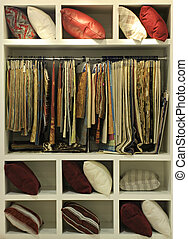 Stand with samples of fabrics at a furniture exhibition.