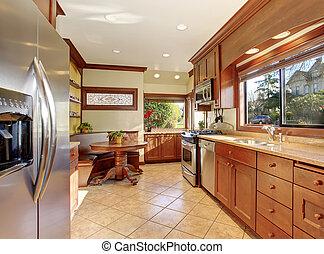 Standard kitchen with tile floor.