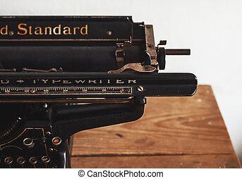 Standard Typewriter - Old vintage typewriter on wooden...