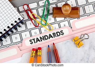 Standards concept. Folder Register on Background of Computer Keyboard