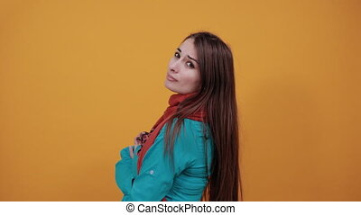 Standing and cross her arms on chest. Young attractive woman...