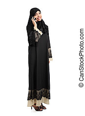Standing arab woman talking on the phone