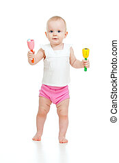 standing baby playing with musical toy