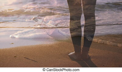 Standing barefoot on the beach