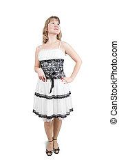 Standing blonde girl in white dress
