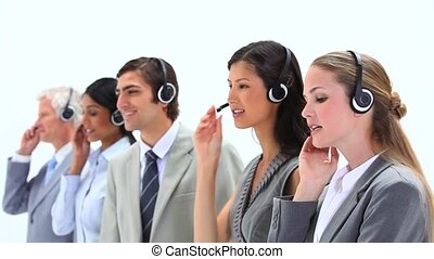Standing business people speaking into headset