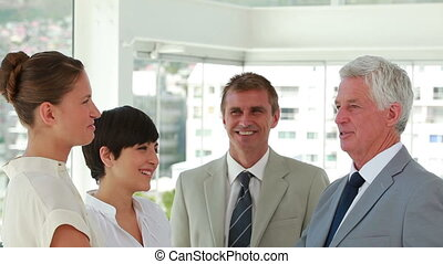 Standing business people talking together