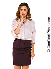 Standing business woman shows gesture silence