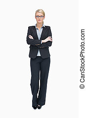 Standing businesswoman with folded arms