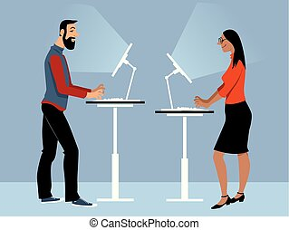 Standing desk ion the office - Male and female employee...