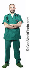 standing doctor with green uniform, crossed arms side view