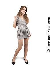 Standing girl in grey dress
