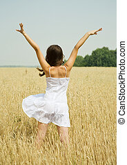 girl in white dress at cereals field