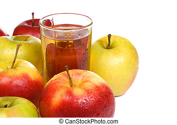 glass full of juice and apples