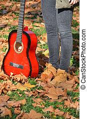 Standing in autumn park