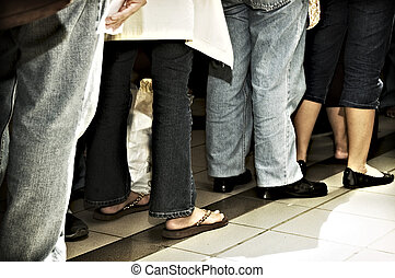 Standing in Line - People standing in line inside a mall