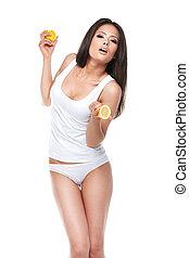 standing, limone, underwear., sopra, due, isolato, metà, asiatico, fondo, presa a terra, sexy, ragazza, brunet, bianco