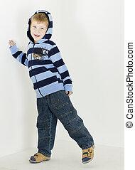 standing little boy