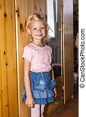 standing little girl wearing a skirt