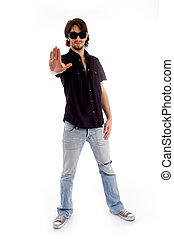 standing male showing stopping hand gesture