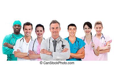 standing, medico, sorridente, braccia, squadra