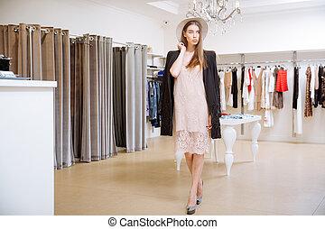 standing, negozio, donna, abbigliamento, moda