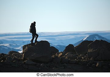 Standing on a cliff