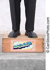 Standing on a Soap Box - Man standing on a soap box