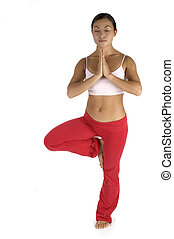 Standing Pose - A female fitness instructor demonstrates a...