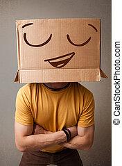 standing, scatola, testa, suo, smiley, giovane, faccia, cartone, gesturing, uomo