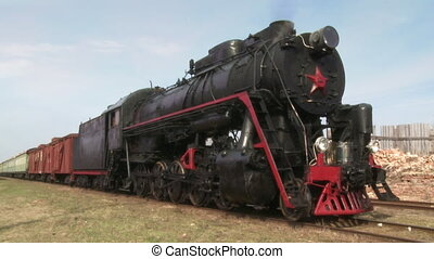 standing steam train   - old train with steam engine