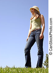 Standing Tall - A young woman standing tall in the grass
