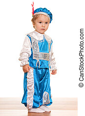 Standing toddler dressed in a carnival suit of a prince