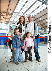 standing traveling family of four